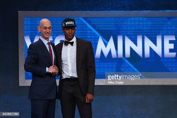 Kris Dunn poses with Commissioner Adam Silver after being drafted fifth overall by the Minnesota Timberwolves in the first round of the 2016 NBA...