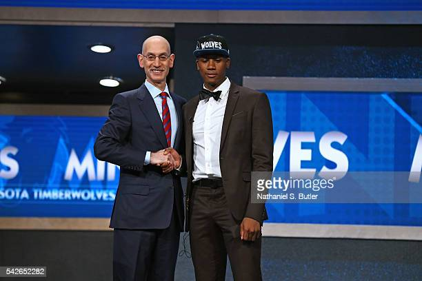 Kris Dunn shakes hands with NBA Commissioner Adam Silver after being selected number five overall by the Minnesota Timberwolves during the 2016 NBA...