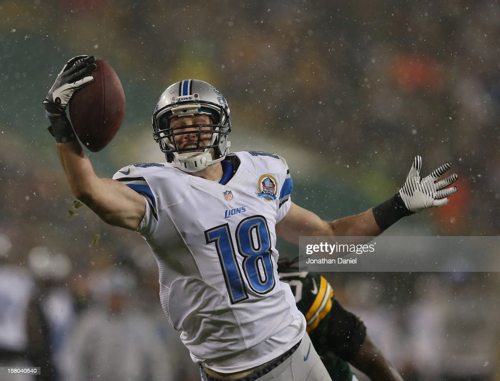 Kris Durham #18 of the Detroit Lions makes a one-handed catch for a long gain against the Green Bay Packers at Lambeau Field on December 9, 2012 in Green Bay, Wisconsin.