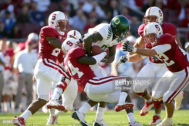 Kris Evans of the Stanford Cardinal tackles Ed Dickson of the Oregon Ducks at Stanford Stadium on November 7 2009 in Palo Alto California