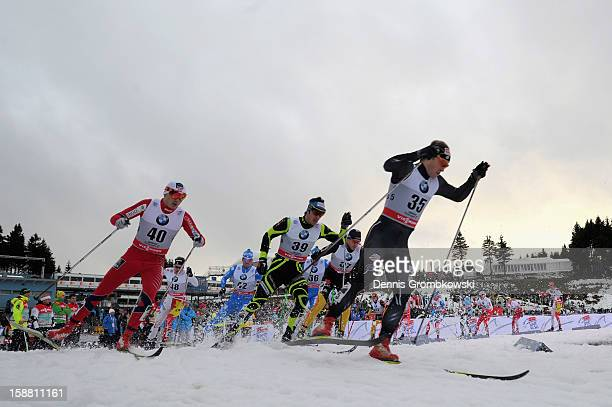 Kris Freeman of the United States is chased by Finn Haagen Krogh of Norway and Cyril Miranda of France during the Men's 15km Classic Pursuit at the...