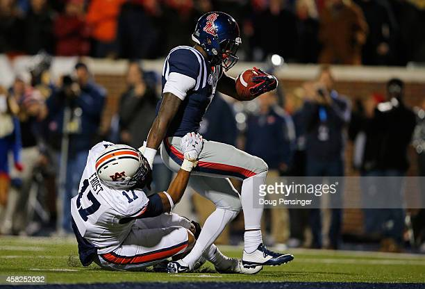 Kris Frost of the Auburn Tigers makes a tackle on Laquon Treadwell of the Mississippi Rebels and forcing a fumble and a turn over in the endzone late...