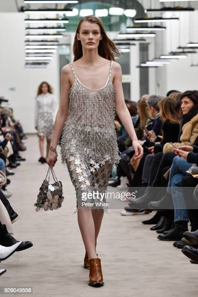 Kris Grikaite walks the runway during the Paco Rabanne show as part of the Paris Fashion Week Womenswear Fall/Winter 2018/2019 on March 1, 2018 in...