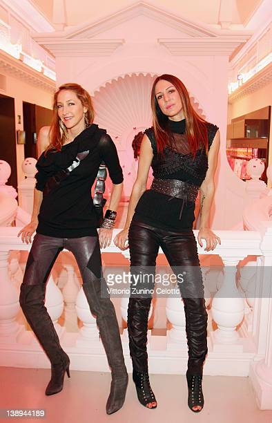 Kris Grove and Kris Reichert attend the 22 Maggio By Maria Grazia Severi collection are displayed on February 14, 2012 in Milan, Italy.