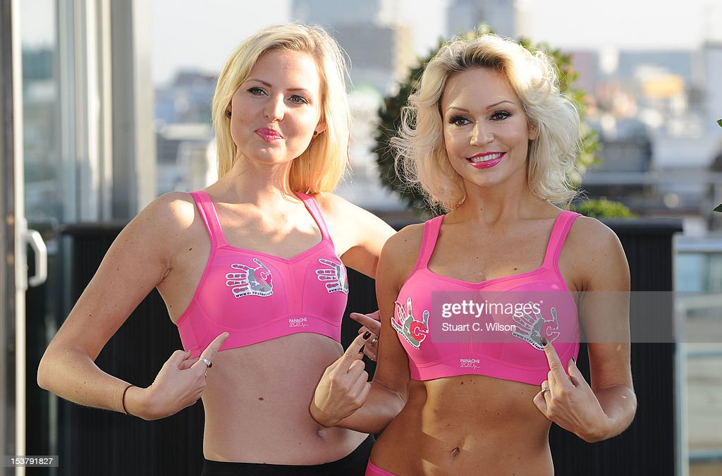 Kris Hallenga and Kristina Rihanoff attend a photocall to launch a Breast Cancer Awareness sports bra on October 9, 2012 in London, England.