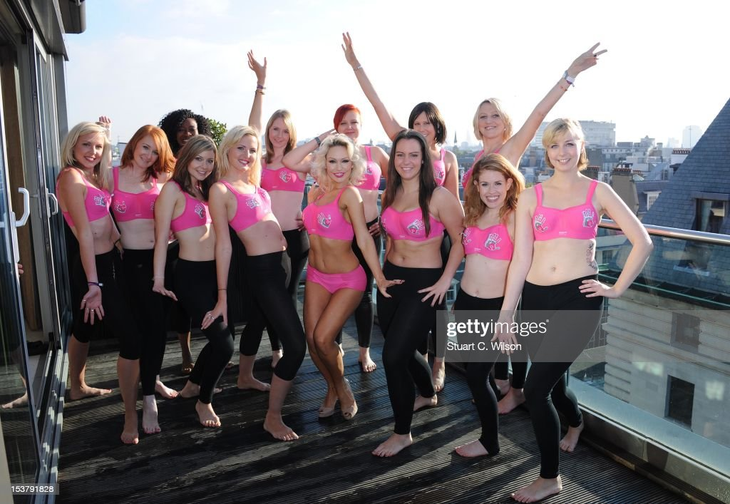 Kris Hallenga and Kristina Rihanoff (C) attend a photocall to launch a Breast Cancer Awareness sports bra on October 9, 2012 in London, England.