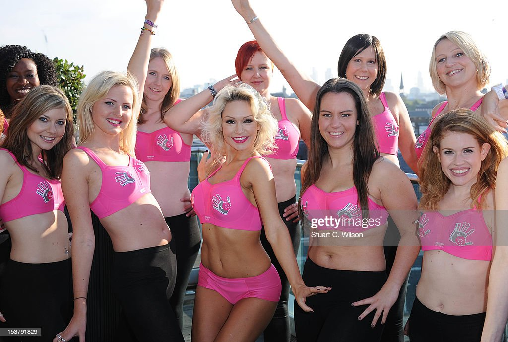 Kris Hallenga (2L) and Kristina Rihanoff (C) attend a photocall to launch a Breast Cancer Awareness sports bra on October 9, 2012 in London, England.