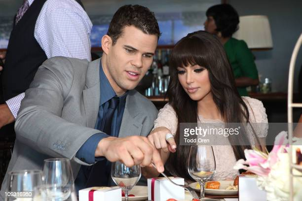 Kris Humphries and Kim Kardashian attend 'A Very Melo Brunch' on February 20 2011 in West Hollywood California