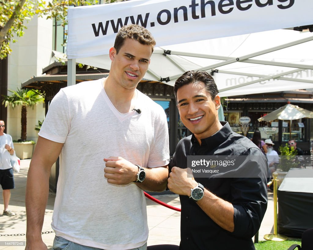 Kris Humphries (L) and Mario Lopez visit 'Extra' at The Grove on May 18, 2012 in Los Angeles, California.