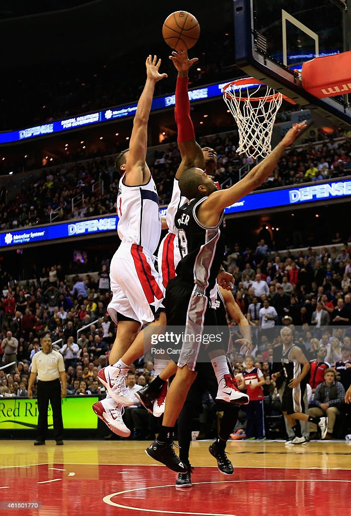 Kris Humphries #43 (L) goes up as Bradley Beal #3 of the Washington Wizards blocks a shot by Tony Parker #9 of the San Antonio Spurs during the second half of the Wizards 101-93 win at Verizon Center on January 13, 2015 in Washington, DC.