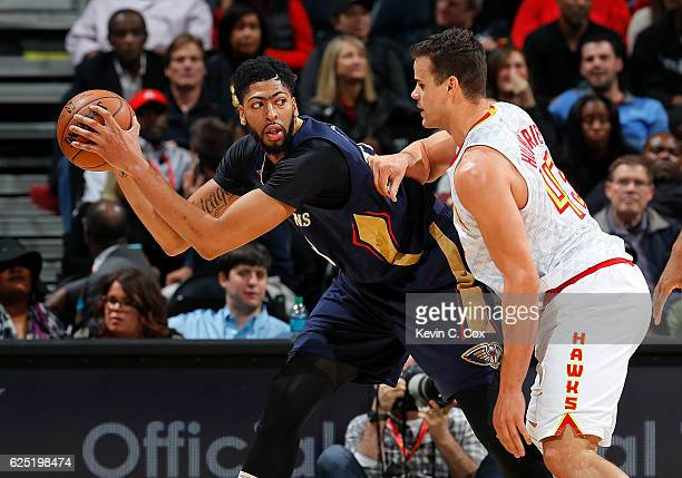 Kris Humphries of the Atlanta Hawks defends against Anthony Davis of the New Orleans Pelicans at Philips Arena on November 22 2016 in Atlanta Georgia...