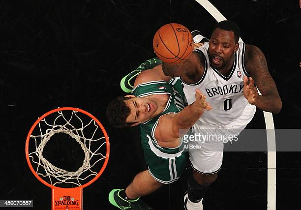 Kris Humphries of the Boston Celtics and Andray Blatche of the Brooklyn Nets battle for the ball during their game at the Barclays Center on December...
