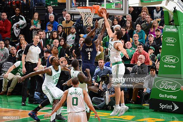 Kris Humphries of the Boston Celtics blocks a shot against Tyreke Evans of the New Orleans Pelicans on January 3, 2014 at the TD Garden in Boston,...