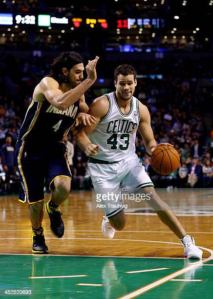 Kris Humphries of the Boston Celtics drives to the basket as Luis Scola of the Indiana Pacers defends during a game at the TD Garden on November 22...