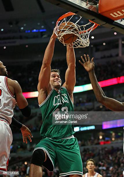 Kris Humphries of the Boston Celtics dunks against the Chicago Bulls at the United Center on January 2 2014 in Chicago Illinois NOTE TO USER User...