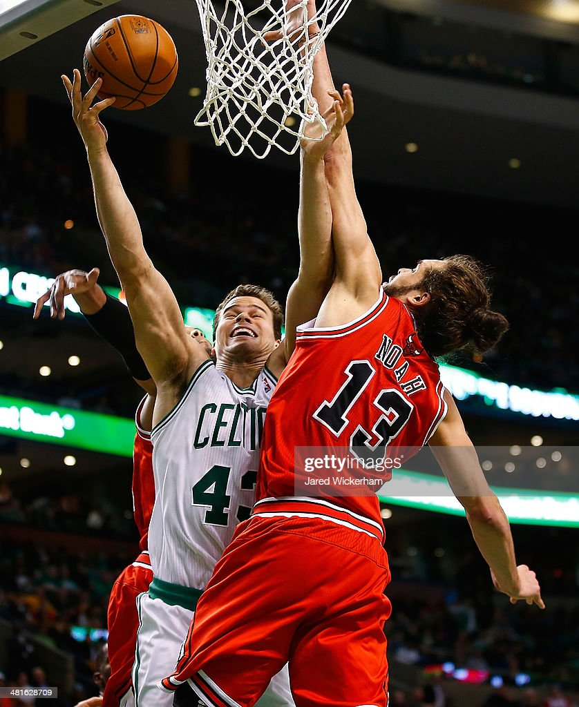 Kris Humphries #43 of the Boston Celtics goes up for a layup in front of Joakim Noah #13 of the Chicago Bulls in the second quarter during the game at TD Garden on March 30, 2014 in Boston, Massachusetts.