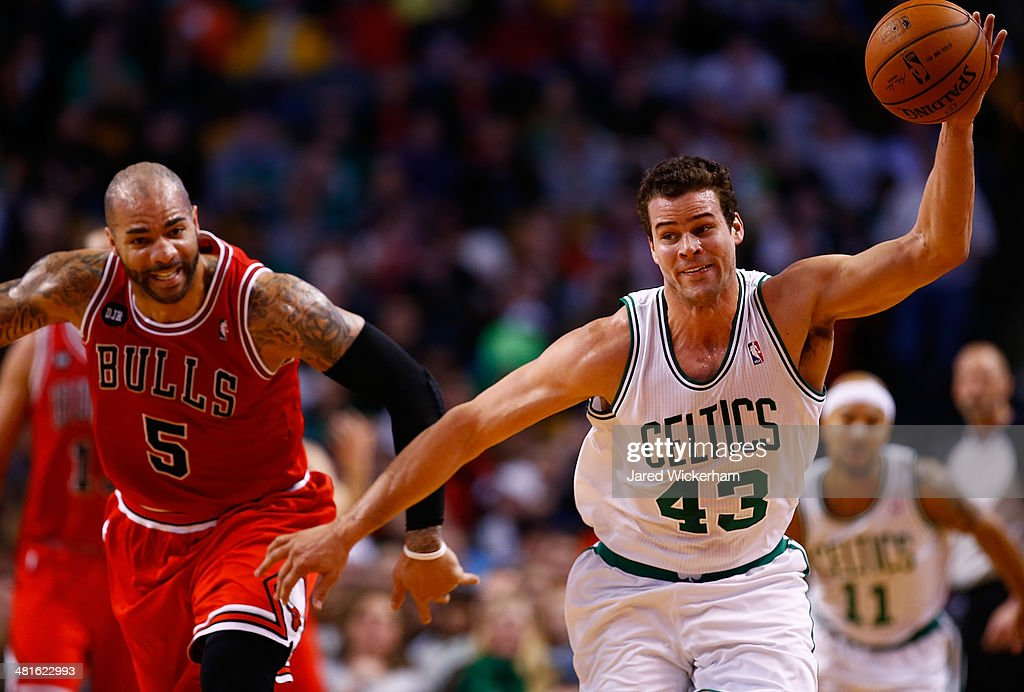 Kris Humphries #43 of the Boston Celtics grabs a loose ball in front of Carlos Boozer #5 of the Chicago Bulls in the first period during the game at TD Garden on March 30, 2014 in Boston, Massachusetts.