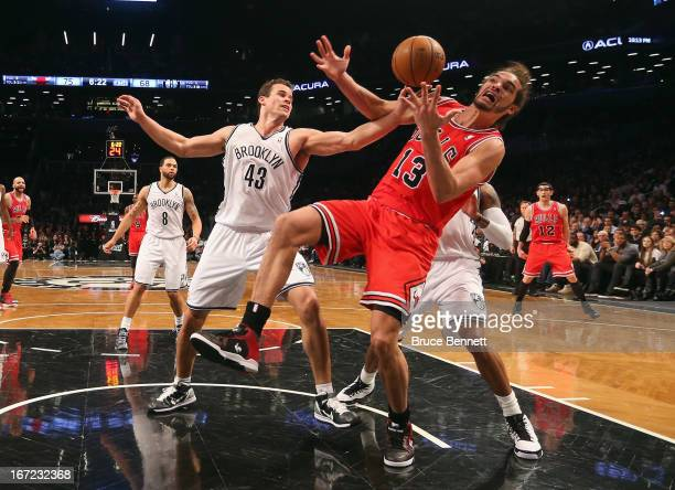Kris Humphries of the Brooklyn Nets blocks a shot by Joakim Noah of the Chicago Bulls during Game Two of the Eastern Conference Quarterfinals of the...