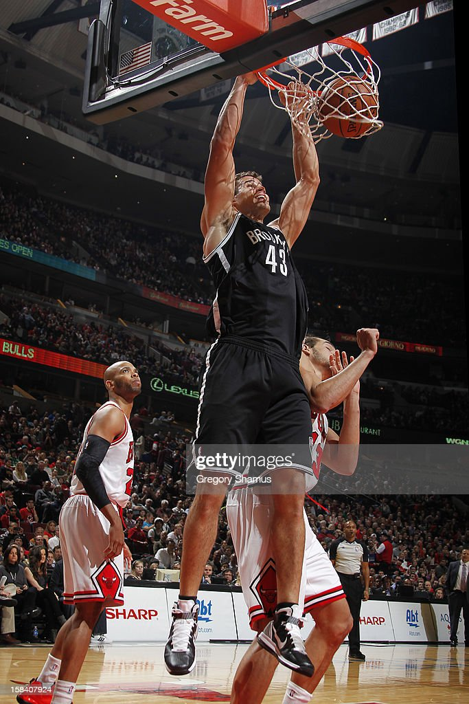 Kris Humphries #43 of the Brooklyn Nets dunks during the game against Chicago Bulls on December 15, 2012 at the United Center in Chicago, Illinois.