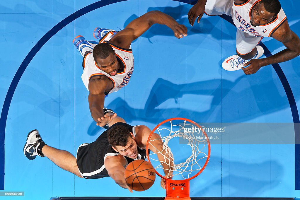 Kris Humphries #43 of the Brooklyn Nets shoots a layup against Serge Ibaka #9 of the Oklahoma City Thunder on January 2, 2013 at the Chesapeake Energy Arena in Oklahoma City, Oklahoma.
