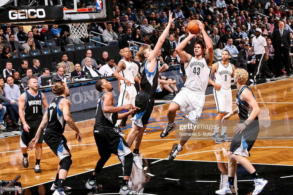 Kris Humphries #43 of the Brooklyn Nets shoots against Andrei Kirilenko #47 of the Minnesota Timberwolves on November 5, 2012 at the Barclays Center in Brooklyn, New York.