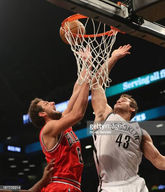 Kris Humphries of the Brooklyn Nets stops Marco Belinelli of the Chicago Bulls during Game Two of the Eastern Conference Quarterfinals of the 2013...