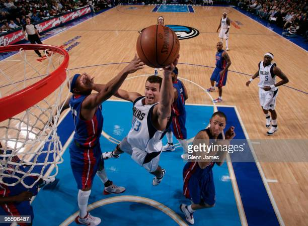 Kris Humphries of the Dallas Mavericks goes up for the layup against Charlie Villanueva of the Detroit Pistons during a game at the American Airlines...