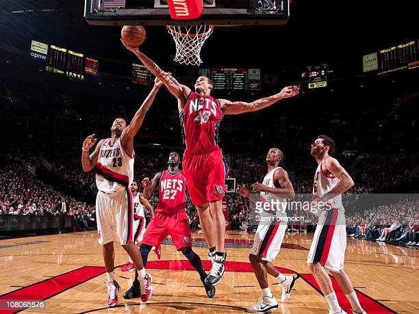 Kris Humphries of the New Jersey Nets goes up for a shot against Marcus Camby of the Portland Trail Blazers during a game on January 15 2011 at the...