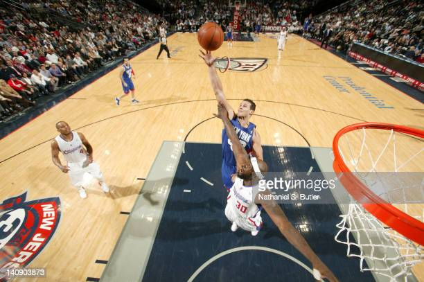 Kris Humphries of the New Jersey Nets rebounds against Reggie Evans of the Los Angeles Clippers during the game on March 7 2012 at the Prudential...