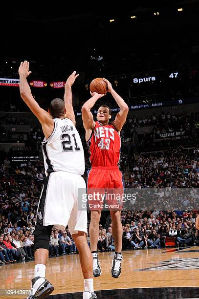 Kris Humphries of the New Jersey Nets shoots against Tim Duncan of the San Antonio Spurs at ATT Center on February 25 2011 in San Antonio Texas NOTE...