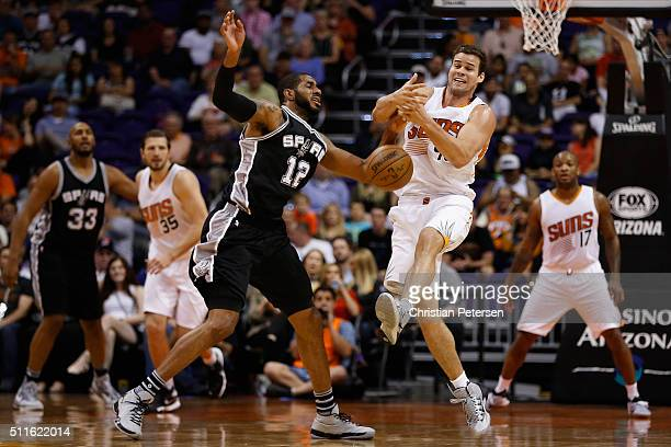 Kris Humphries of the Phoenix Suns and LaMarcus Aldridge of the San Antonio Spurs reach for a loose ball during the first half of the NBA game at...