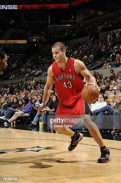 Kris Humphries of the Toronto Raptors dribbles the ball against the San Antonio Spurs during the game at the ATT Center on December 28 2007 in San...