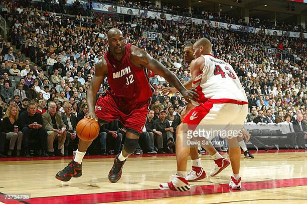 Kris Humphries of the Toronto Raptors guards against Shaquille O'Neal of the Miami Heat on March 28 2007 at the Air Canada Centre in Toronto Canada...