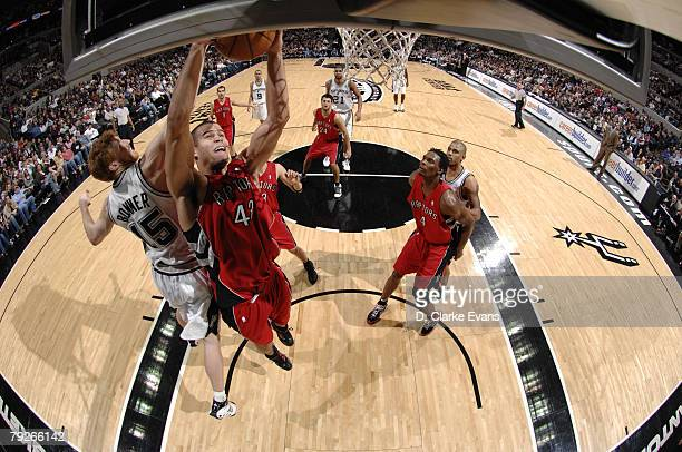 Kris Humphries of the Toronto Raptors rebounds the ball against the San Antonio Spurs during the game at the ATT Center on December 28 2007 in San...