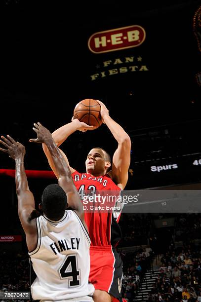 Kris Humphries of the Toronto Raptors shoots against Michael Finley of the San Antonio Spurs at the ATT Center December 28 2007 in San Antonio Texas...