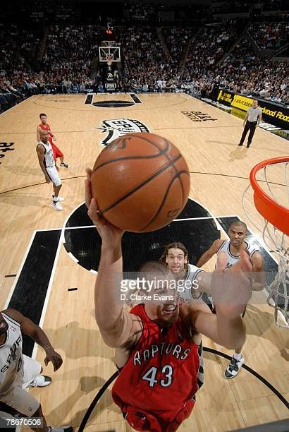 Kris Humphries of the Toronto Raptors shoots against the San Antonio Spurs at the ATT Center December 28 2007 in San Antonio Texas NOTE TO USER User...