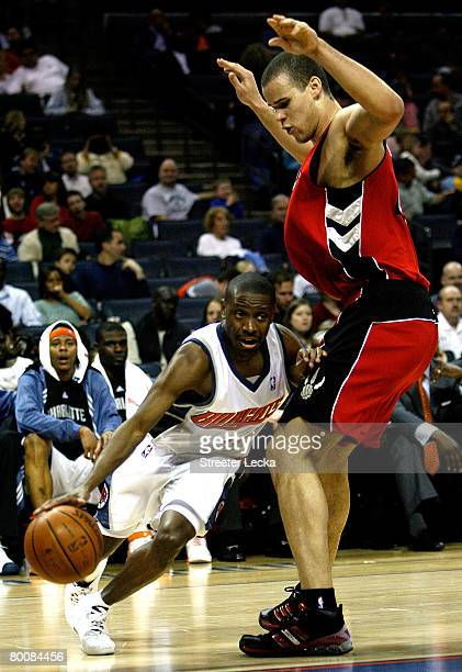 Kris Humphries of the Toronto Raptors tries to stop Earl Boykins of the Charlotte Bobcats during their game at Bobcats Arena on March 2, 2008 in...