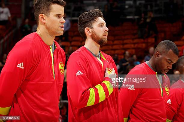 Kris Humphries Ryan Kelly and Paul Millsap of the Atlanta Hawks stand for a moment of silence for the National Anthem before the game against the...