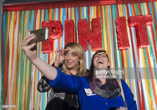 Kris Israel and Kate Miano take a selfie during a Pinterest media event at the company's corporate headquarters in San Francisco California on April...