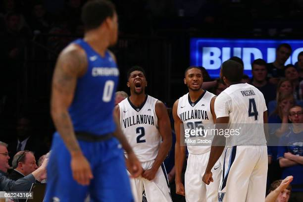 Kris Jenkins Mikal Bridges and Eric Paschall of the Villanova Wildcats celebrate as Marcus Foster of the Creighton Bluejays look on during the Big...