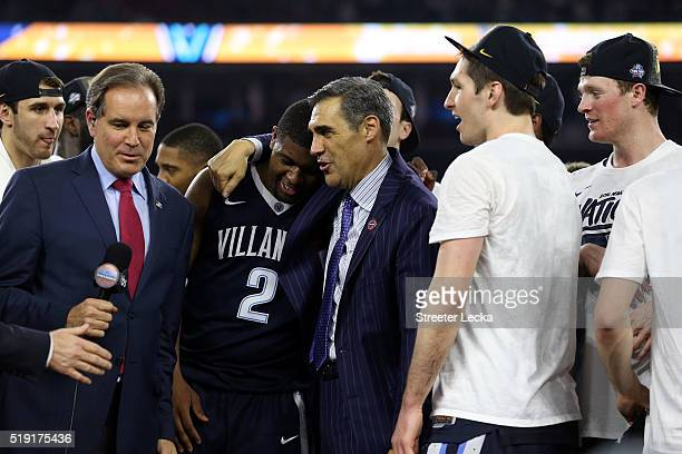 Kris Jenkins of the Villanova Wildcats celebrates with head coach Jay Wright after defeating the North Carolina Tar Heels 7774 to win the 2016 NCAA...
