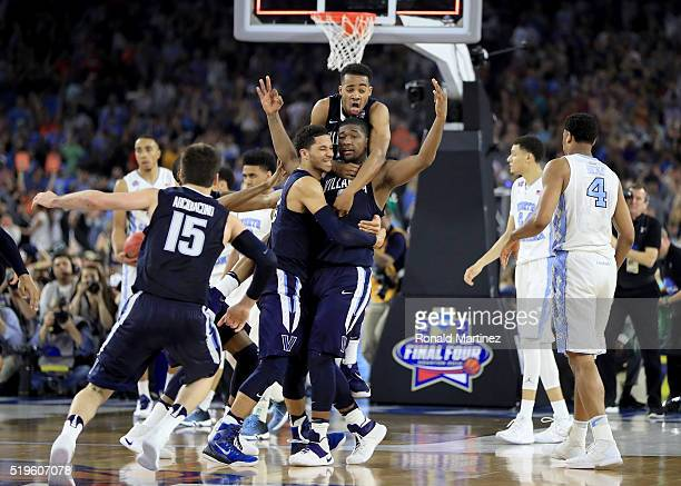 Kris Jenkins of the Villanova Wildcats celebrates with teammates after making the gamewinning three pointer to defeat the North Carolina Tar Heels...