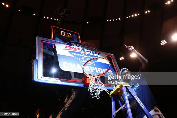 Kris Jenkins of the Villanova Wildcats cuts a piece of the net after defeating the Creighton Bluejays to win the Big East Basketball Tournament -...