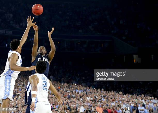 Kris Jenkins of the Villanova Wildcats shoots the game-winning three pointer to defeat the North Carolina Tar Heels 77-74 in the 2016 NCAA Men's...