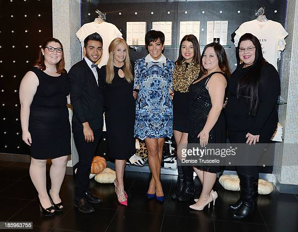 Kris Jenner and Cici Bussey pose for photos with the Kardashian Khaos team at Kardashian Khaos in the Mirage Hotel and Casino on October 26 2013 in...