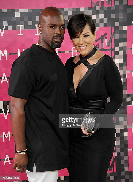 Kris Jenner and Corey Gamble arrive at the 2015 MTV Video Music Awards at Microsoft Theater on August 30 2015 in Los Angeles California