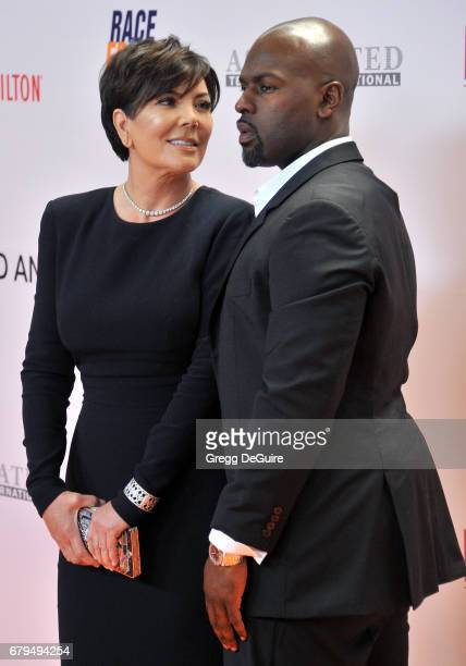 Kris Jenner and Corey Gamble arrive at the 24th Annual Race To Erase MS Gala at The Beverly Hilton Hotel on May 5 2017 in Beverly Hills California