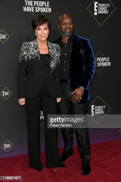 Kris Jenner and Corey Gamble attend the 2019 E People's Choice Awards at Barker Hangar on November 10 2019 in Santa Monica California