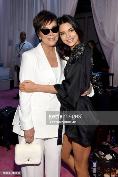 Kris Jenner and Kendall Jenner pose backstage during the 2018 Victoria's Secret Fashion Show in New York at Pier 94 on November 8 2018 in New York...