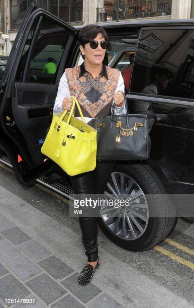 Kris Jenner with two Hermes Birkin handbags worth almost £15000 each on April 24, 2013 in London, England.